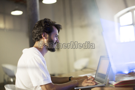casual businessman working at laptop in