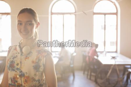 portrait smiling casual businesswoman with headphones