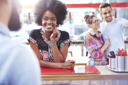 smiling woman at counter in cafe