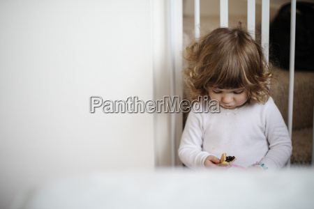 girl eating snack on stairs