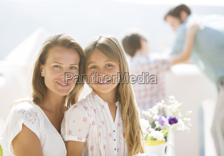 mother and daughter smiling outdoors