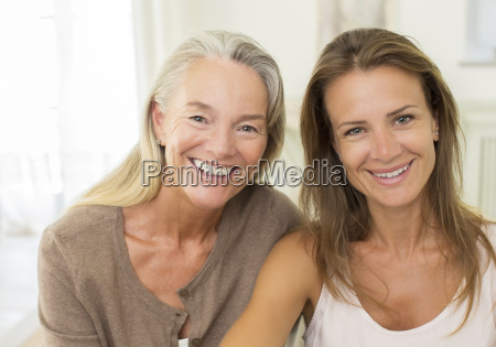 mother and daughter smiling indoors