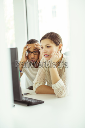 people working on computer in office