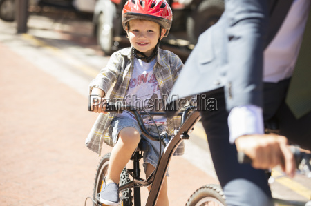 portrait smiling boy riding bicycle on