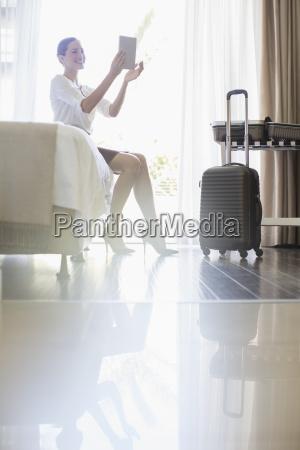 businesswoman using digital tablet in hotel