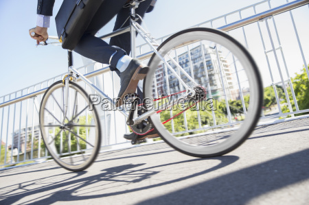 low section businessman in suit riding