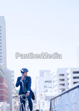 businessman in suit and helmet talking