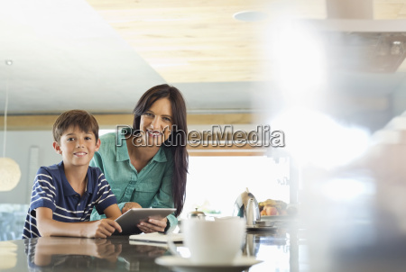 mother and son using tablet computer