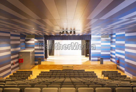 seating and stage in empty auditorium