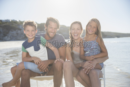 family sitting together in waves