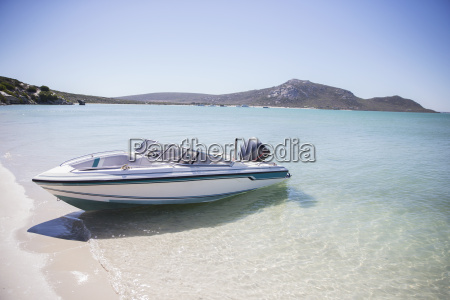 speedboat beached on shore
