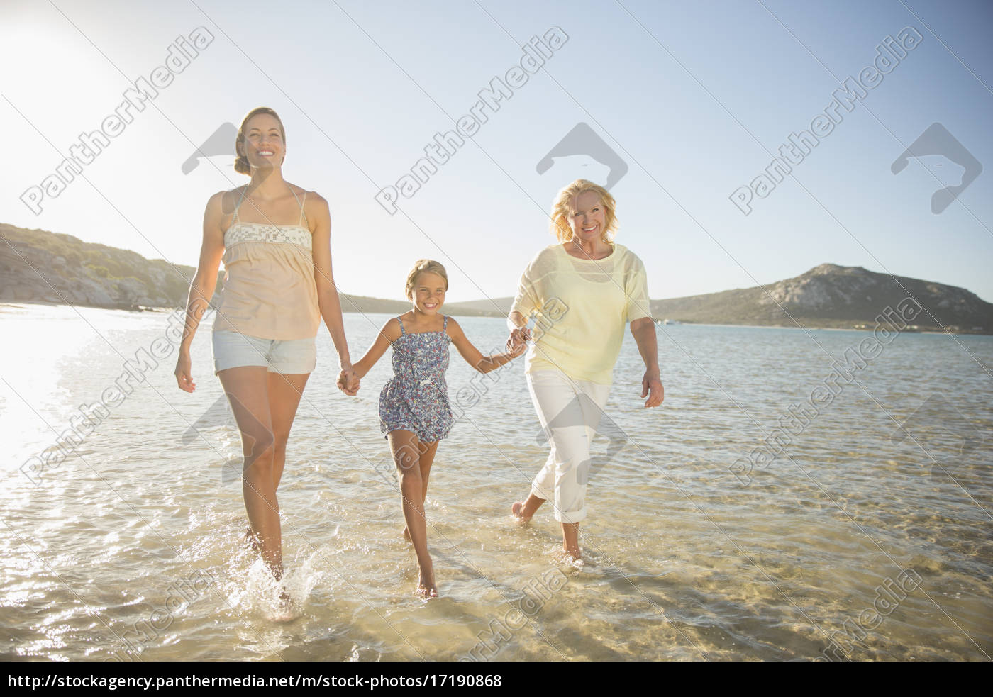 three, generations, of, women, walking, in - 17190868