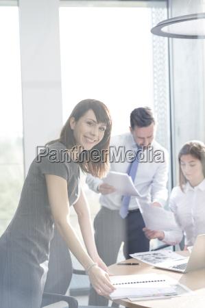 portrait confident businesswoman in conference room