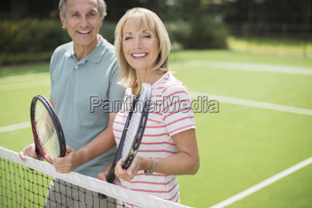 couple smiling on tennis court