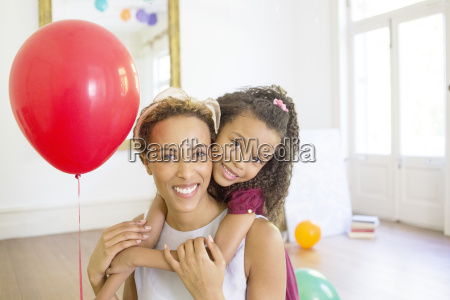 mother and daughter hugging in living