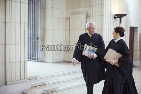 judges walking through courthouse together