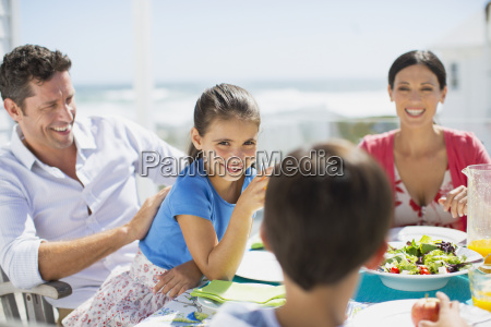 family eating lunch at table on