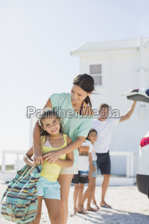 mother and daughter hugging in sunny