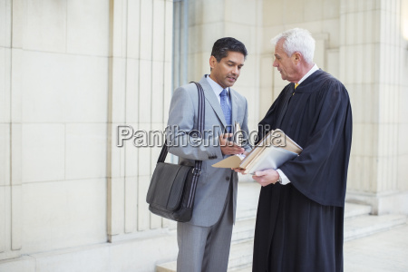 judge and lawyer examining documents in