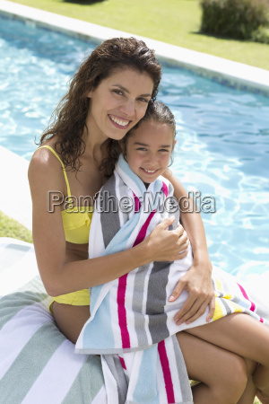 mother and daughter relaxing by swimming