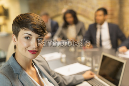 portrait confident businesswoman with laptop in