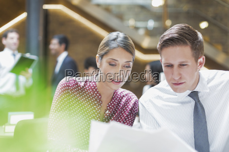 business people reviewing paperwork in office