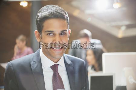 close up portrait smiling businessman