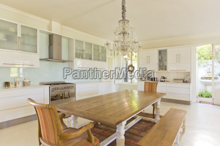 chandelier over wooden table in kitchen