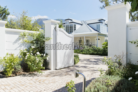 driveway with open gate to luxury