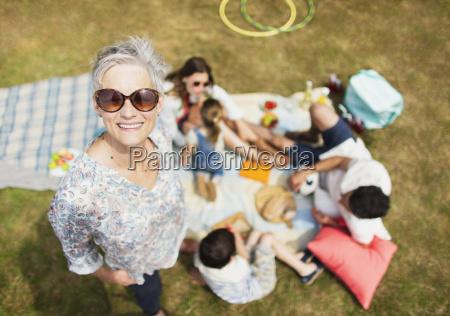 portrait smiling senior woman with family