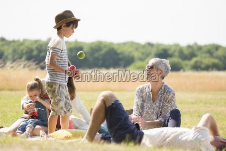 multi generation family in sunny field