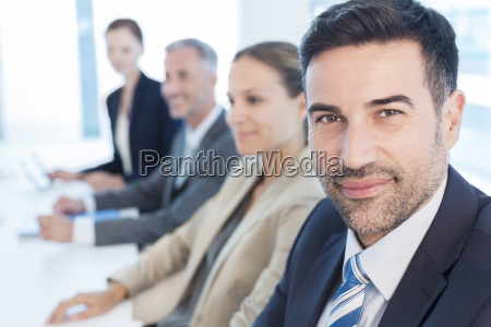 portrait of confident businessman in conference