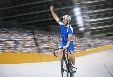 track cyclist celebrating in velodrome
