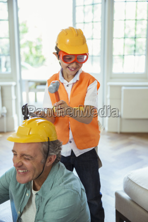 father and son playing with construction
