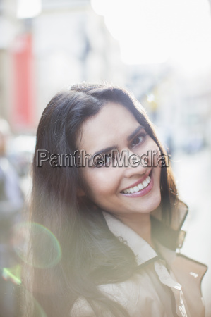 woman smiling on city street
