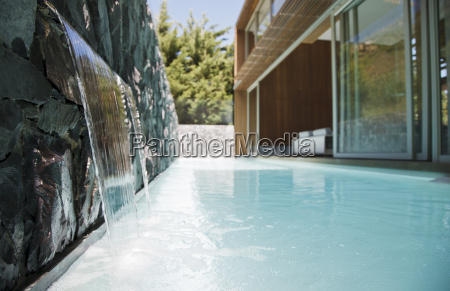 waterfall emptying into pool of modern