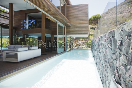 lap pool next to modern house