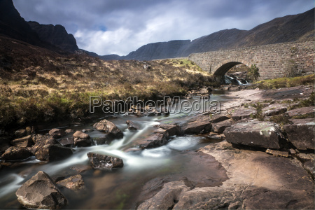 stream flowing under remote aqueduct scotland