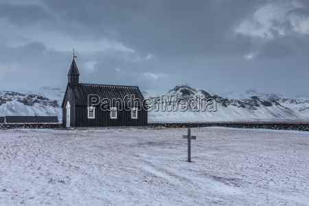 church and graveyard in snowy remote