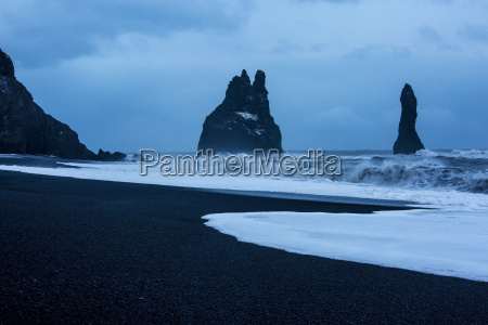 rock formations and stormy ocean at