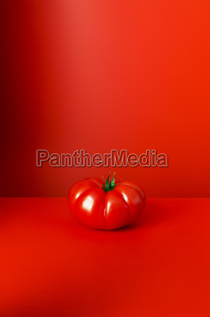 tomato sitting on red counter