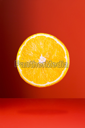 orange slice on red counter