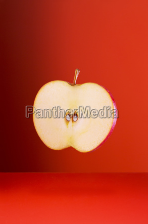 apple slice on red counter