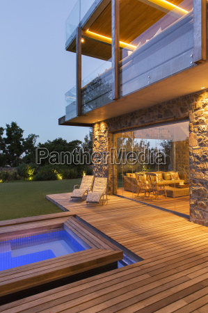 modern house overlooking swimming pool and