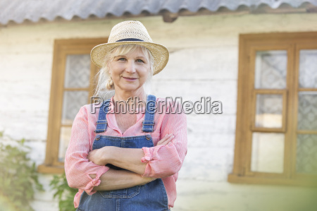 portrait smiling farmer in overalls and