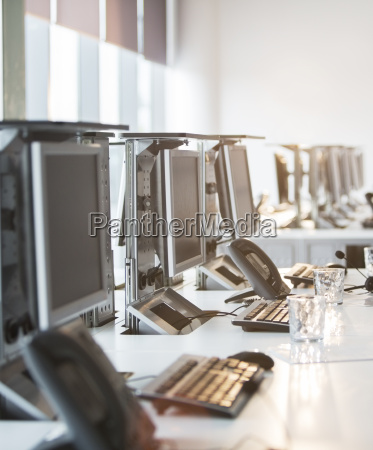 computers and telephones at desk in