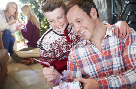 family exchanging gifts on christmas
