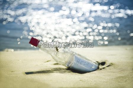 message in bottle on beach