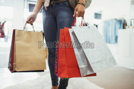 woman carrying shopping bags in clothing