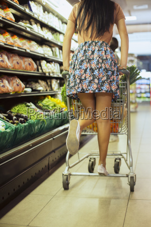 woman playing on shopping cart in
